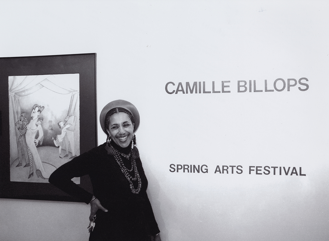 Camille Billops poses in front of her artwork
